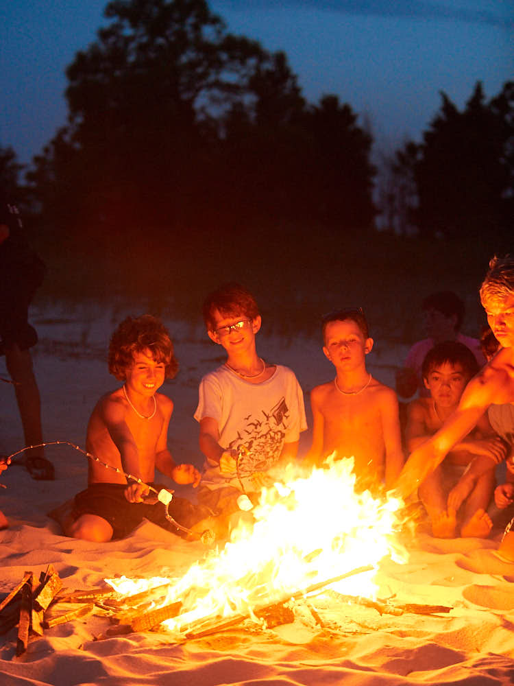 Josh pilarski, drew sadikman, will subin, Daniel Matthews roast marshmellows at Camp Sea Gull