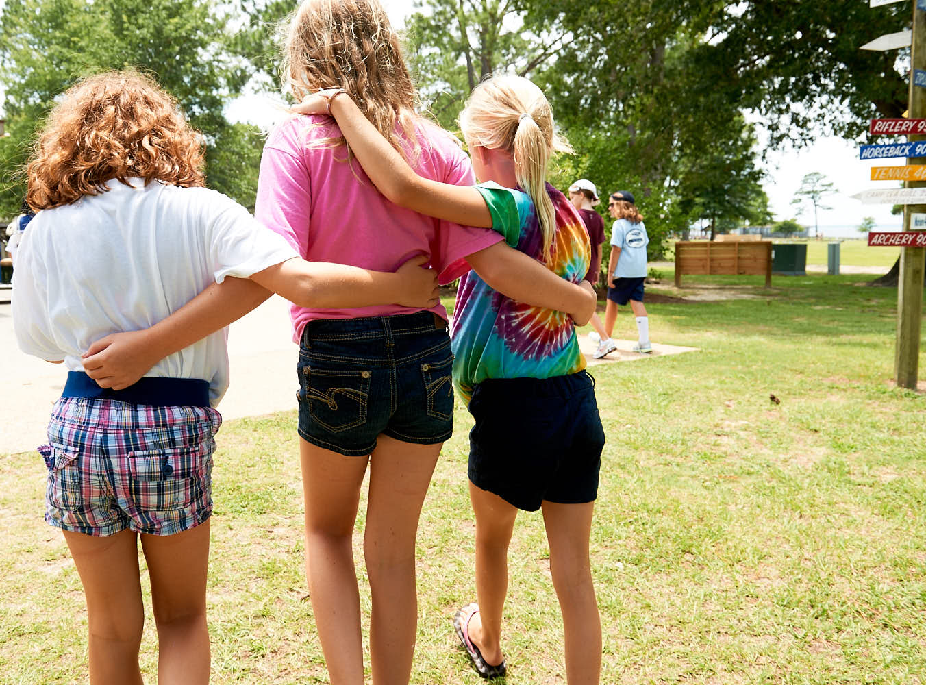 Friends at Camp Seafarer walk back to their cabin together
